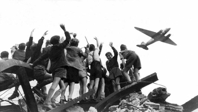 """Children flocked to Tempelhof in anticipation of candy drops by incoming U.S. Airlift aircraft. This became known as """"Operation Little Vittles."""" Author's Collection"""